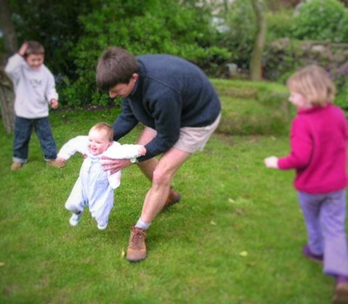 children-playing-with-baby-and-man